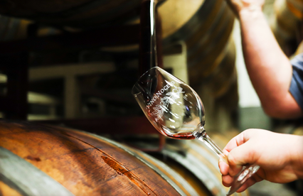 Pouring wine from barrel